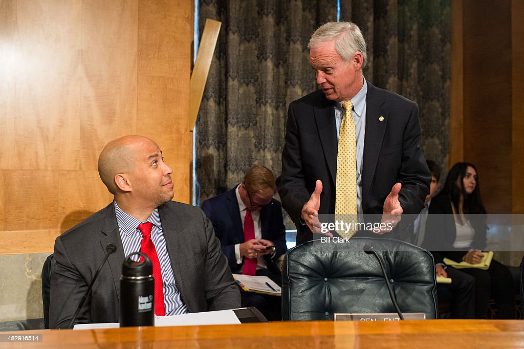 Sen. <a gi-track='captionPersonalityLinkClicked' href=/galleries/search?phrase=Cory+Booker&family=editorial&specificpeople=638070 ng-click='$event.stopPropagation()'>Cory Booker</a> (D-NJ) left, speaks with chairman Sen. <a gi-track='captionPersonalityLinkClicked' href=/galleries/search?phrase=Ron+Johnson+-+Pol%C3%ADtico&family=editorial&specificpeople=12902569 ng-click='$event.stopPropagation()'>Ron Johnson</a> (R-WI) during the Senate Homeland Security and Governmental Affairs Committee hearing on 'Oversight of the Bureau of Prisons: First-Hand Accounts of Challenges Facing the Federal Prison System' on Tuesday, Aug. 4, 2015.