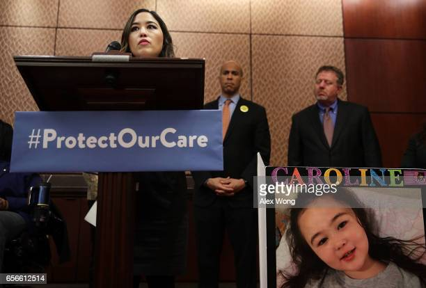 S Sen Cory Booker listens as Marta Conner of Clifton Virginia whose 7yearold daughter Caroline has Rett Syndrome and currently on Medicaid speaks...