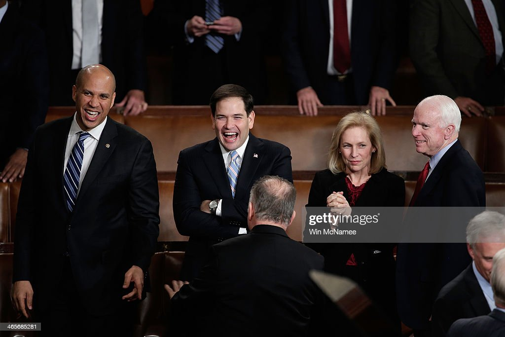 U.S. Sen. <a gi-track='captionPersonalityLinkClicked' href=/galleries/search?phrase=Cory+Booker&family=editorial&specificpeople=638070 ng-click='$event.stopPropagation()'>Cory Booker</a> (D-NJ), U.S. Sen. <a gi-track='captionPersonalityLinkClicked' href=/galleries/search?phrase=Marco+Rubio+-+Politician&family=editorial&specificpeople=11395287 ng-click='$event.stopPropagation()'>Marco Rubio</a> (R-FL), U.S. Sen. Kristen Gillibrand (D-NY) , and U.S. Sen. <a gi-track='captionPersonalityLinkClicked' href=/galleries/search?phrase=John+McCain&family=editorial&specificpeople=125177 ng-click='$event.stopPropagation()'>John McCain</a> (R-AZ) wait for U.S. President Barack Obama to deliver the State of the Union address to a joint session of Congress in the House Chamber at the U.S. Capitol on January 28, 2014 in Washington, DC. In his fifth State of the Union address, Obama is expected to emphasize on healthcare, economic fairness and new initiatives designed to stimulate the U.S. economy with bipartisan cooperation.