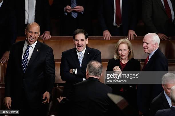 US Sen Cory Booker US Sen Marco Rubio US Sen Kristen Gillibrand and US Sen John McCain wait for US President Barack Obama to deliver the State of the...