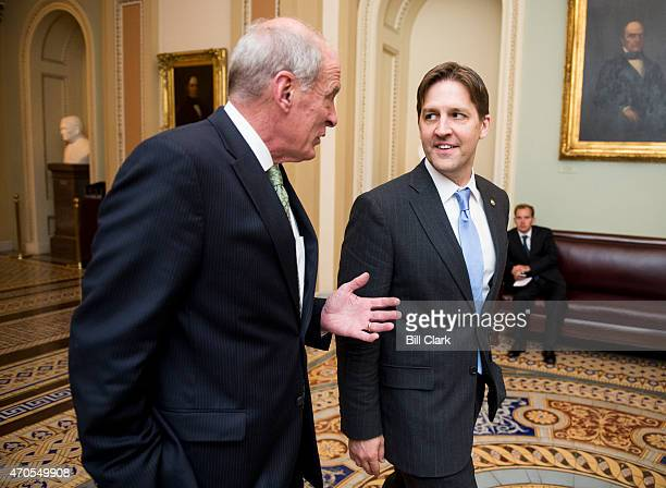 Sen Dan Coats RInd left speaks with Sen Ben Sasse RNeb as they arrives for the Senate Republicans' policy lunch in the Capitol on Tuesday April 21...