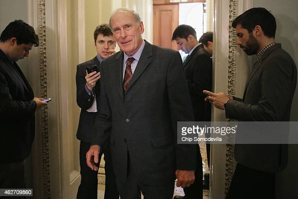 Sen Dan Coats talks with reporters before heading into the weekly GOP policy luncheon at the US Capitol February 3 2015 in Washington DC Congress is...