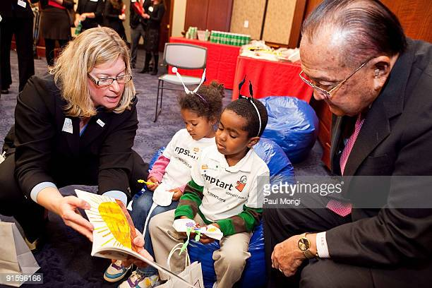 Sen Dan Inouye right helps read to children at Jump Start's 'Read for the Record' at Capitol Hill on October 8 2009 in Washington DC