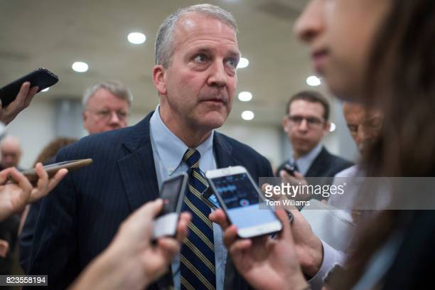 Sen Dan Sullivan RAlaska talks with reporters in the senate subway before a lunch in the Capitol on July 27 2017