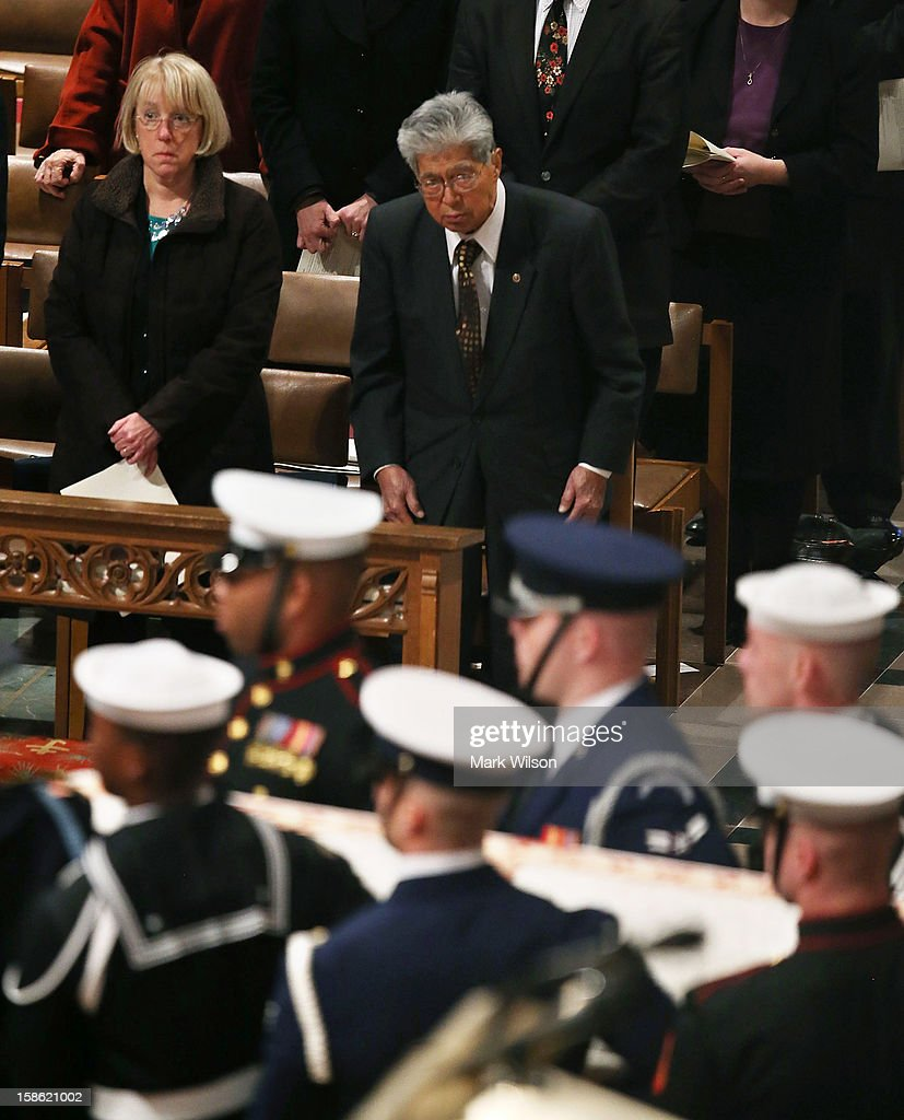 Sen. Daniel Akaka (D-HI) (R) and Sen. Patty Murray (D-WA) (L) watch as the casket of Sen. Daniel Inouye (D-HI) is carried past during a funeral service at the National Cathedral on December 21, 2012 in Washington, DC. Sen. Inouye, who was the most senior senator and a Medal of Honor recipient, died on December 17 at the age of 88.