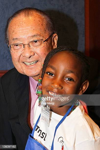 Sen Daniel Inouye poses for a photo with a Jumpstart child at Jumpstart's Read For The Record event at the US Capitol Visitor Center on October 6...