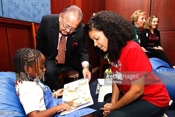Sen Daniel Inouye reads to a Jumpstart child at Jumpstart's Read For The Record event at the US Capitol Visitor Center on October 6 2011 in...