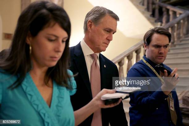 Sen David Perdue heads into the Senate Republican policy luncheon at the US Capitol August 1 2017 in Washington DC After failing to pass legislation...