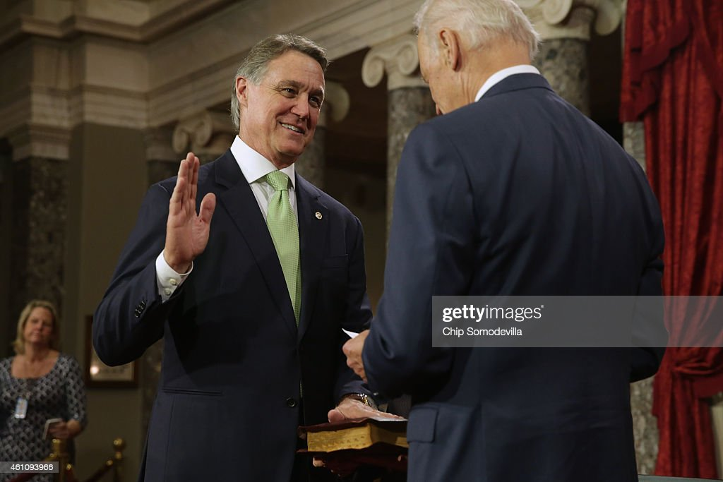 Sen. <a gi-track='captionPersonalityLinkClicked' href=/galleries/search?phrase=David+Perdue&family=editorial&specificpeople=4276858 ng-click='$event.stopPropagation()'>David Perdue</a> (R-GA) (L) is ceremonially sworn in by Vice President Joe Biden in the Old Senate Chamber at the U.S. Capitol January 6, 2015 in Washington, DC. The 114th Congress convened on Tuesday, restoring control of both the House and Senate to the Republicans for the first time in eight years.