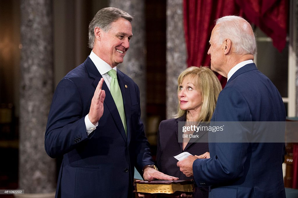 Sen. <a gi-track='captionPersonalityLinkClicked' href=/galleries/search?phrase=David+Perdue&family=editorial&specificpeople=4276858 ng-click='$event.stopPropagation()'>David Perdue</a>, R-Ga., and Vice President Joe Biden participate in the re-enactment swearing-in ceremony in the Old Senate Chamber on Tuesday, Jan. 6, 2015.