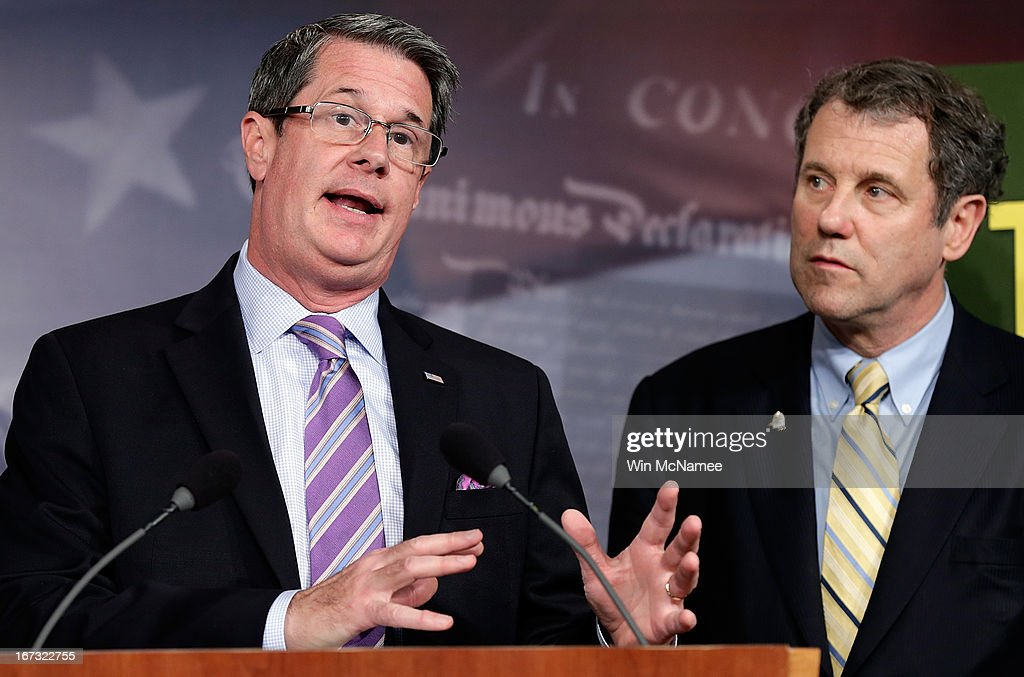 Sen. <a gi-track='captionPersonalityLinkClicked' href=/galleries/search?phrase=David+Vitter&family=editorial&specificpeople=506565 ng-click='$event.stopPropagation()'>David Vitter</a> (R-LA) (L) and Sen. <a gi-track='captionPersonalityLinkClicked' href=/galleries/search?phrase=Sherrod+Brown&family=editorial&specificpeople=3986311 ng-click='$event.stopPropagation()'>Sherrod Brown</a> (D-OH) (R) speak during a press conference announcing the details of 'Too Big to Fail' legislation at the U.S. Capitol April 24, 2013 in Washington, DC. The legislation would include capital requirements for financial institutions to protect against losses and prevent the use of federal funds to bail them out should they fail.