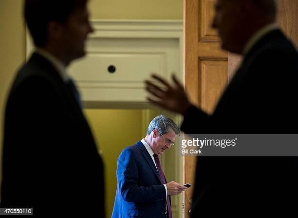 Sen David Vitter RLa center talks on his cell phone as Sens Ben Sasse RNebleft and Dan Coats RInd right talk outside of the Senate Republicans'...