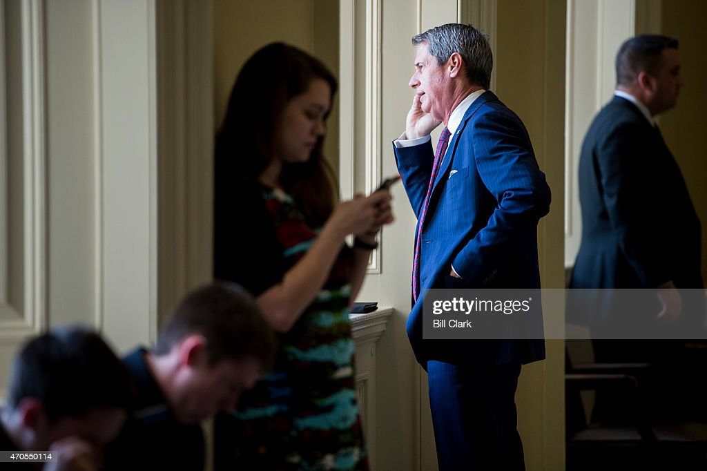 Sen. <a gi-track='captionPersonalityLinkClicked' href=/galleries/search?phrase=David+Vitter&family=editorial&specificpeople=506565 ng-click='$event.stopPropagation()'>David Vitter</a>, R-La., talks on his cell phone outside of the Senate Republicans' policy lunch in the Capitol on Tuesday, April 21, 2015.