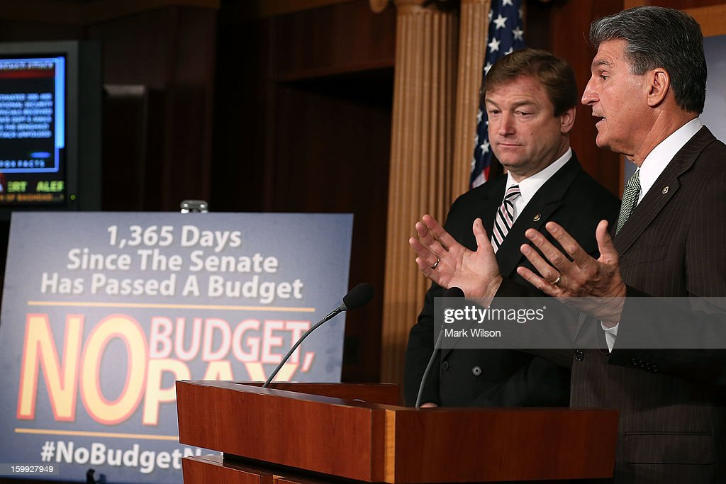 Sen. Dean Heller (R-NV) (L) and Sen. Joe Manchin (D-WV) speak about the ''No Budget No Pay'' legislation during a news conference on Capitol Hill, January 23, 2013 in Washington, DC. The bipartisan legislation would require members of Congress to pass a budget in order to receive their pay.