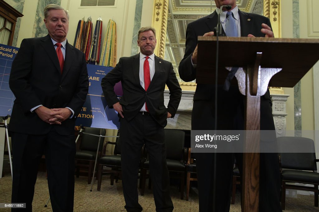 U.S. Sen. Dean Heller (R-NV) (2nd L) and Sen. Lindsey Graham (R-SC) (L) listen during a news conference on health care September 13, 2017 on Capitol Hill in Washington, DC. Senators Graham, Cassidy, Heller and Johnson unveiled a proposed legislation to repeal and replace the Obamacare.