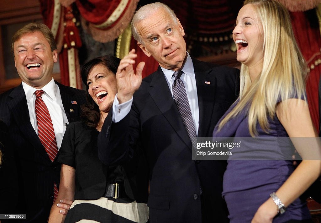Sen. Dean Heller (R-NV) (L), his wife Lynne Heller and daughter Hilary Ableser laugh at a joke told by Vice President Joe Biden after Heller's mock swearing-in in the Old Senate Chamber at the U.S. Capitol May 9, 2011 in Washington, DC. Appointed to the senate by Gov. Brian Sandoval, Heller replaced Sen. John Ensign, who resigned last week amid an investigation of ethics violations.