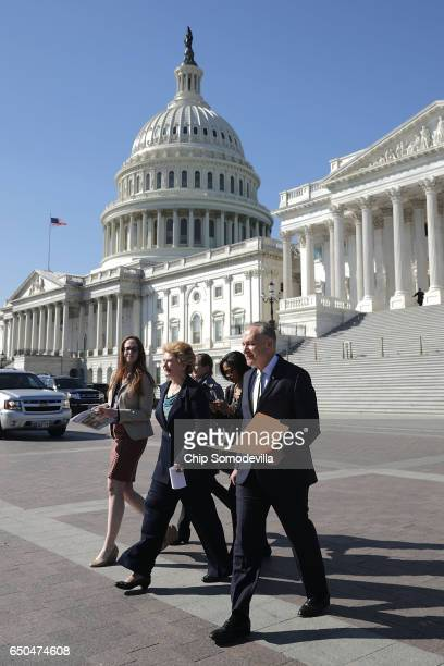 Sen Debbie Stabenow and Senate Minority Leader Charles Schumer head for a news conference with people who may be negatively affected by the proposed...