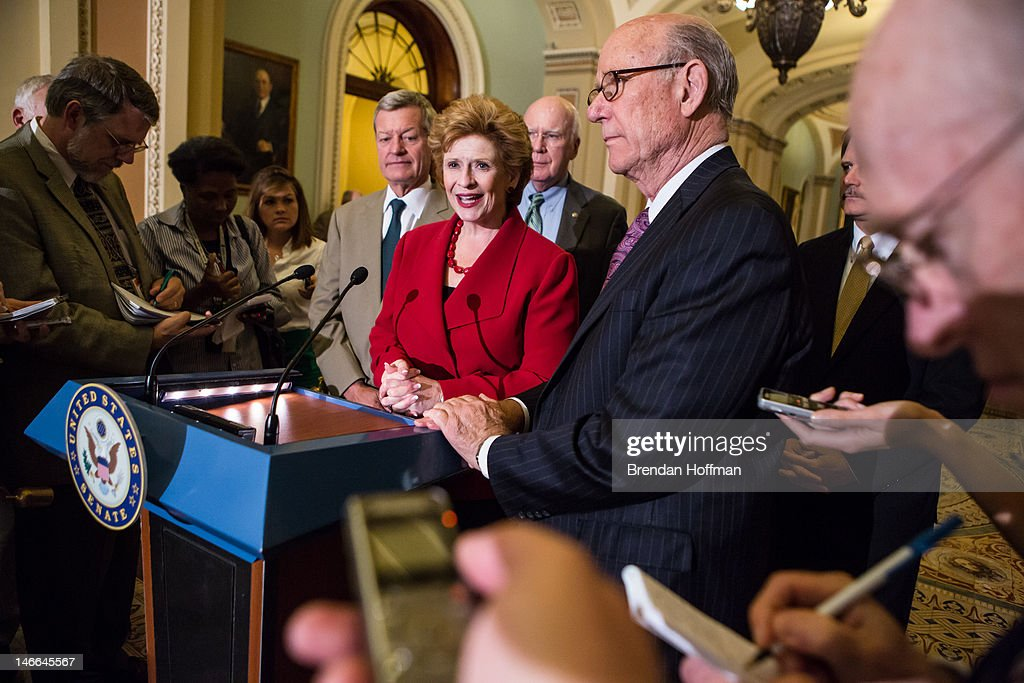 Sen Debbie Stabenow chair of the Senate Agriculture Committee speaks at a news conferece on Capitol Hill as Sen Max Baucus and Sen Pat Roberts listen...