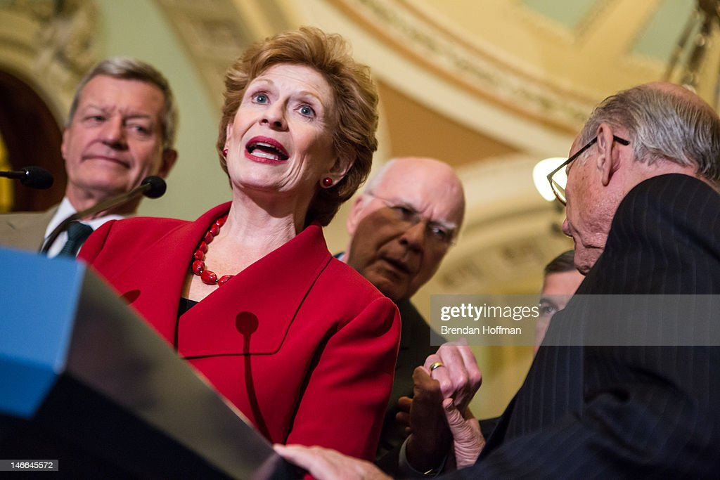 Sen Debbie Stabenow chair of the Senate Agriculture Committee speaks at a news conferece on Capitol Hill as Sen Max Baucus Sen Patrick Leahy and Sen...