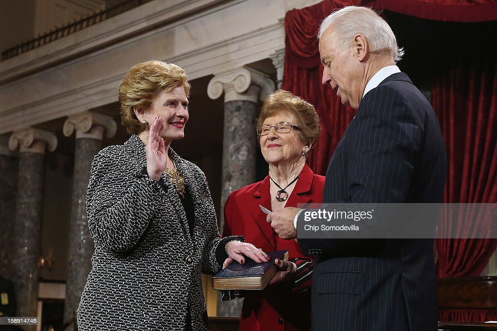 U.S. Sen. Debbie Stabenow (D-MI) (L) participates in a reenacted swearing-in with her mother Anna Greer and U.S. Vice President Joe Biden in the Old Senate Chamber at the U.S. Capitol January 3, 2013 in Washington, DC. Biden swore in the newly-elected and re-elected senators earlier in the day on the floor of the current Senate chamber.