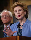 Sen Debbie Stabenow speaks about ending sequestration while flanked by Senate Budget Committee ranking member Bernie Sanders during a news conference...