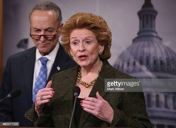 Sen Debbie Stabenow speaks about the Keystone XL pipeline while flanked by Sen Chuck Schumer during a news conference on January 29 2015 at the US...