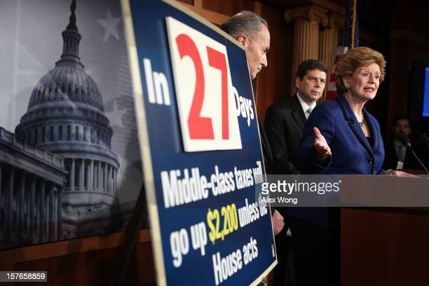 S Sen Debbie Stabenow speaks as Sen Charles Schumer and Sen Mark Begich listen during a news conference December 5 2012 on Capitol Hill in Washington...