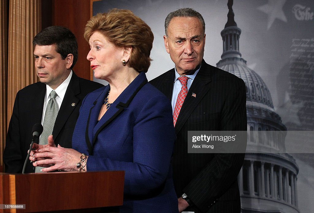 U.S. Sen. Debbie Stabenow (D-MI) (C) speaks as Sen. Charles Schumer (D-NY) (R) and Sen. Mark Begich (D-AK) listen during a news conference December 5, 2012 on Capitol Hill in Washington, DC. The senators held a news conference to call on House Republicans to pass the Senate-passed tax cut bill.