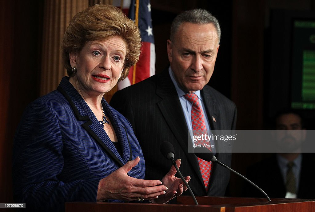 U.S. Sen. Debbie Stabenow (D-MI) (L) speaks as Sen. Charles Schumer (D-NY) listens during a news conference December 5, 2012 on Capitol Hill in Washington, DC. The senators held a news conference to call on House Republicans to pass the Senate-passed tax cut bill.
