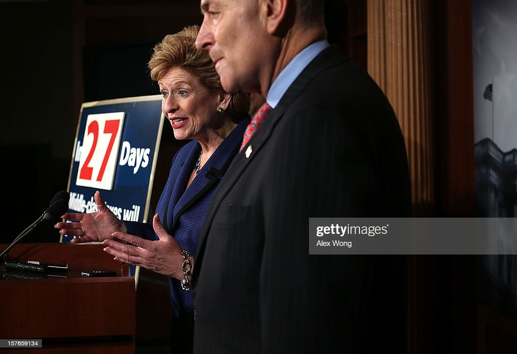 U.S. Sen. <a gi-track='captionPersonalityLinkClicked' href=/galleries/search?phrase=Debbie+Stabenow&family=editorial&specificpeople=221624 ng-click='$event.stopPropagation()'>Debbie Stabenow</a> (D-MI) (L) speaks as Sen. <a gi-track='captionPersonalityLinkClicked' href=/galleries/search?phrase=Charles+Schumer&family=editorial&specificpeople=171249 ng-click='$event.stopPropagation()'>Charles Schumer</a> (D-NY) listens during a news conference December 5, 2012 on Capitol Hill in Washington, DC. The senators held a news conference to call on House Republicans to pass the Senate-passed tax cut bill.
