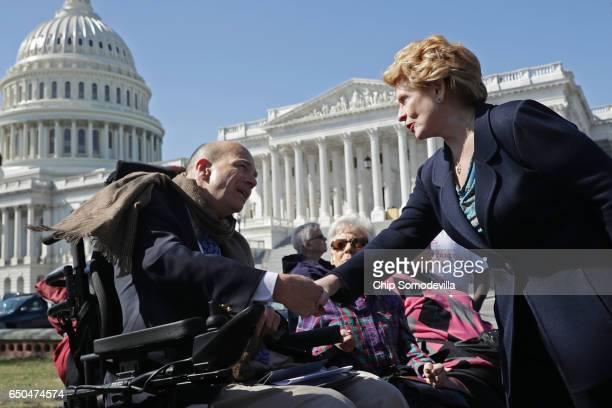 Sen Debbie Stabenow thanks Kent Keyser following a news conference with people who may be negatively affected by the proposed American Health Care...