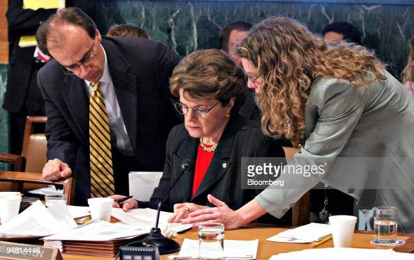 Sen Dianne Feinstein center confers with staff during a Senate Judiciary Committee hearing on a proposed $140 billion trust fund to compensate...