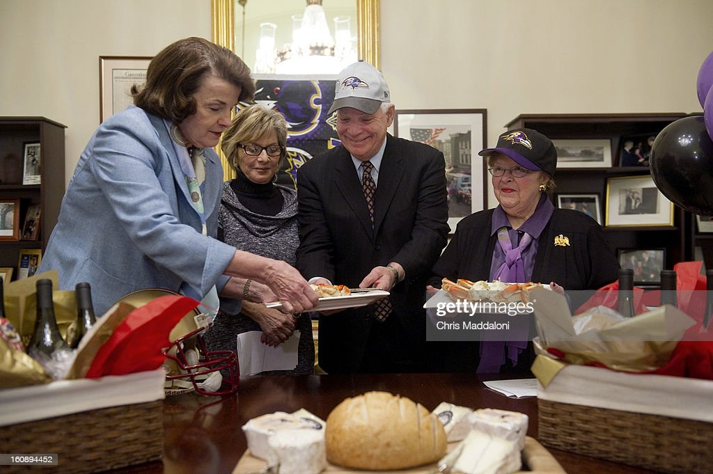 Sen. Dianne Feinstein, D-Calif.; and Sen. Barbara Boxer, D-Calif.; pay off a Supr Bowl bet with Sen. Ben Cardin, D-Md; and Sen. Barbara Mikulski, D-Md. Following the Baltimore Ravens' victory over the San Francisco 49ers, the California Senators gave them Dungness crab, Napa Valley wine, sourdough bread and a selection of Northern California cheeses.