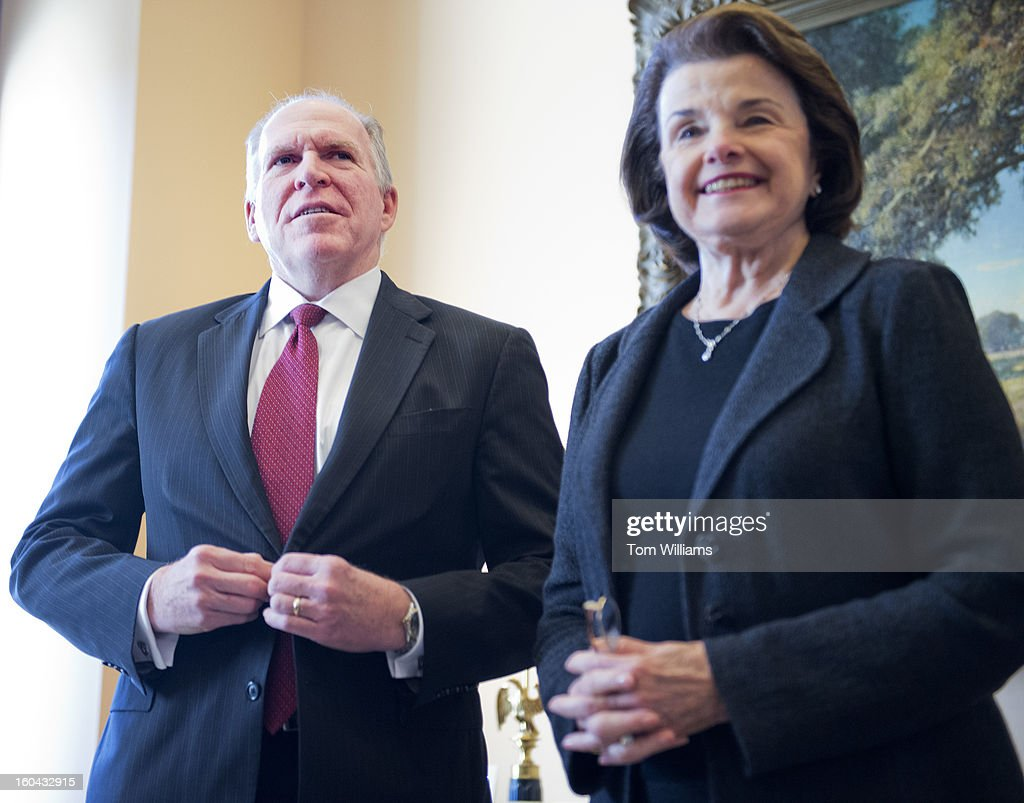 Sen. Dianne Feinstein, D-Calif., Chairman of the Senate Intelligence Committee, poses for a photo in her Hart Building office with John Brennan, nominee to be Director of the Central Intelligence Agency.