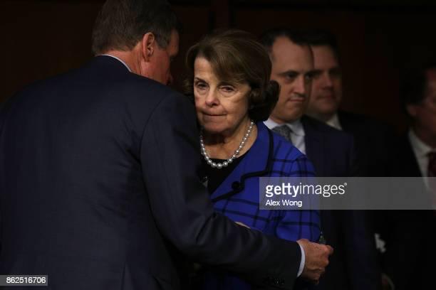 Sen Dianne Feinstein listens to committee vice chairman Sen Mark Warner prior to a confirmation hearing for Acting Inspector General of Central...