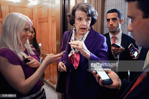 Sen Dianne Feinstein talks to reporters following the weekly Democratic Senate policy luncheon at the US Capitol June 23 2015 in Washington DC The...