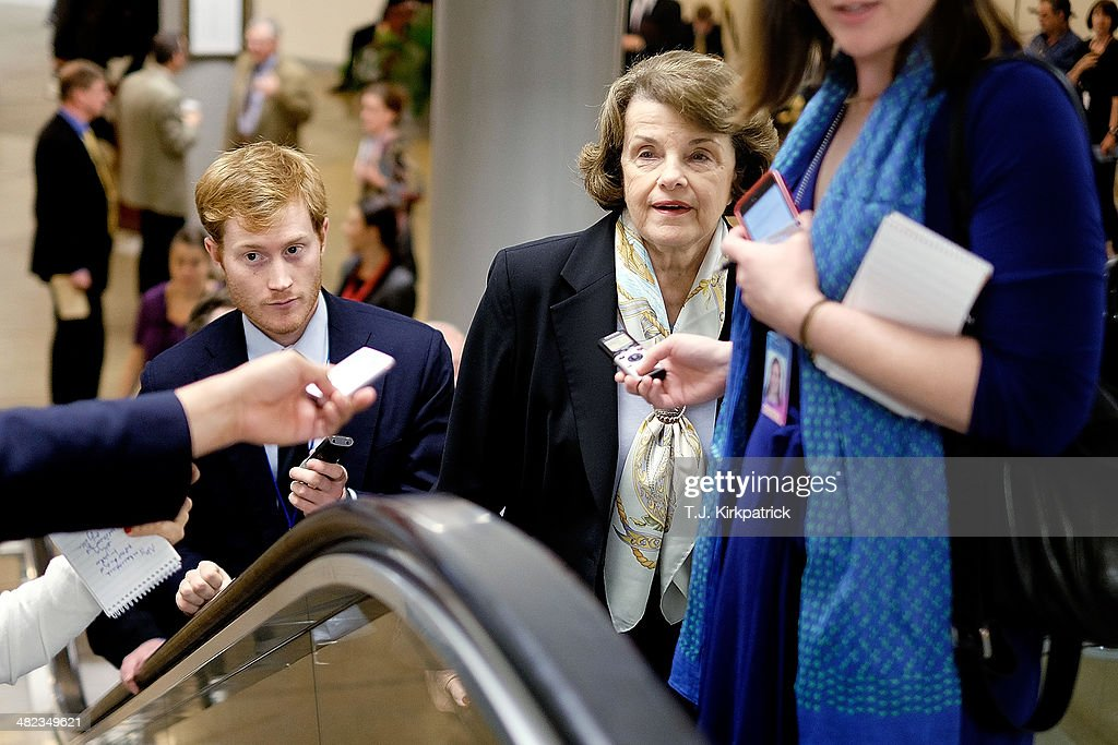 Sen. <a gi-track='captionPersonalityLinkClicked' href=/galleries/search?phrase=Dianne+Feinstein&family=editorial&specificpeople=214078 ng-click='$event.stopPropagation()'>Dianne Feinstein</a> (D-CA) talks with reporters on her way to the Senate Chamber to vote on the Reed-Heller unemployment insurance bill on April 3, 2014 in Washington, DC. The bill, which cleared a final hurdle and is expected to pass the Senate on Monday, would reinstate emergency unemployment insurance benefits for five months.