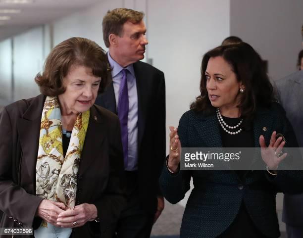 Sen Dianne Feinstein walks with Sen Kamala Harris and Sen Mark Warner to a Senate Select Committee on Intelligence closed door meeting at the US...