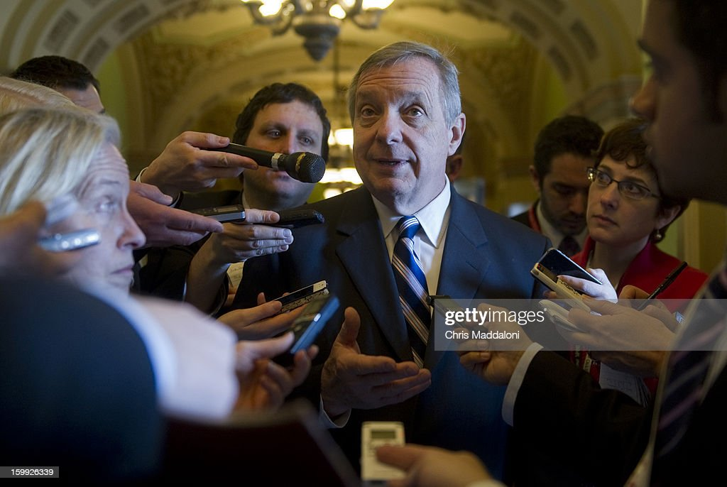 Sen. Dick Durbin, D-Ill., takes questions in the Capitol from the media about the debt ceiling fight. House GOP leaders announced yesterday that they would support extending the nation's borrowing limit temporarily while emphasizing the need for Congress to pass a budget.
