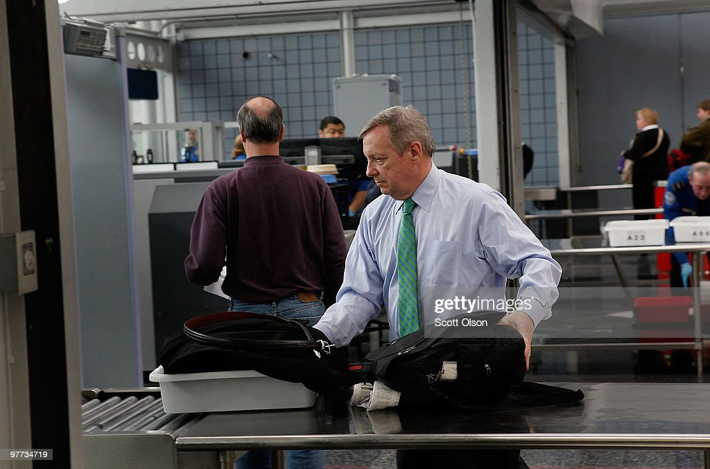 S Sen Dick Durbin passes through a Transportation Security Administration security checkpoint at O'Hare International Airport on March 15 2010 in...