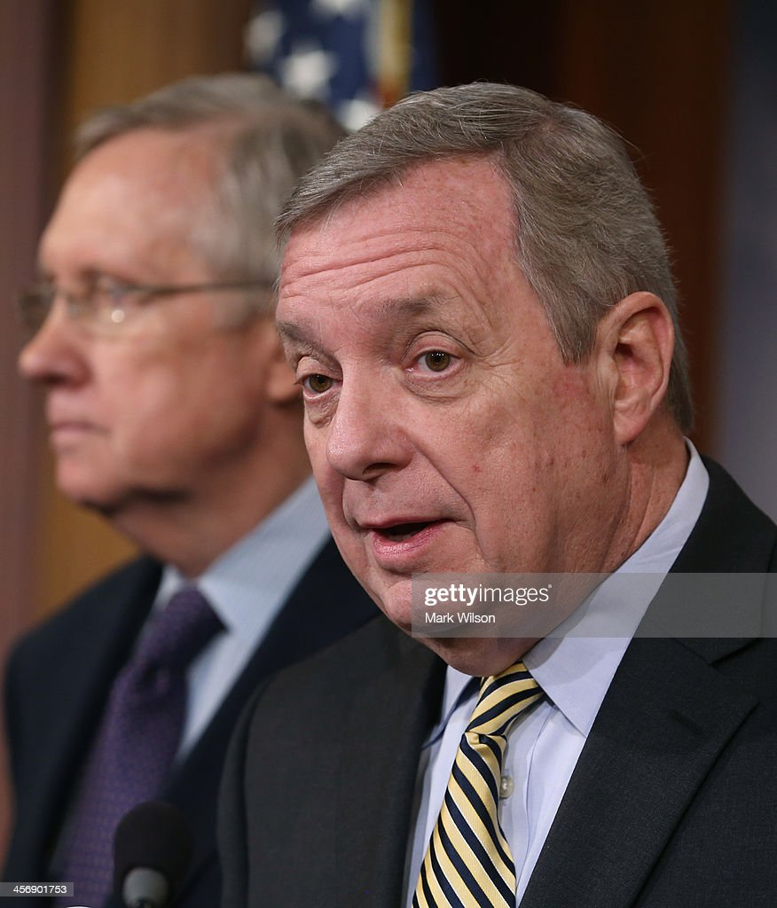 Sen. <a gi-track='captionPersonalityLinkClicked' href=/galleries/search?phrase=Dick+Durbin&family=editorial&specificpeople=208219 ng-click='$event.stopPropagation()'>Dick Durbin</a> (D-IL) (R) speaks while flanked by Senate Majority Leader <a gi-track='captionPersonalityLinkClicked' href=/galleries/search?phrase=Harry+Reid+-+Politician&family=editorial&specificpeople=203136 ng-click='$event.stopPropagation()'>Harry Reid</a> (D-NV) during a news conference on Capitol Hill, on December 12, 2013 in Washington, DC. Senate Democrats talked about the proposed budget deal and Republicans efforts to block President Obama's Circuit court nominees.