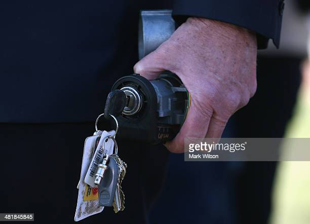 Sen Ed Markey holds a GM ignition switch during a news conference at the US Capitol on April 1 2014 in Washington DC The families want to know why it...