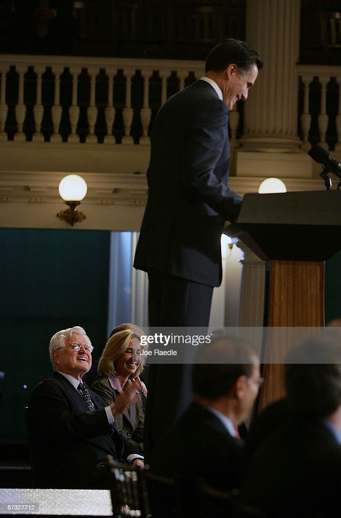 U.S. Sen. Edward Kennedy (D-MA) laughs as Massachusetts Governor Mitt Romney speaks during a ceremony for Romney to sign a new health care reform bill at Faneuil Hall April 12, 2006 in Boston, Massachusetts. The law makes Massachusetts the first state in the country to require that all residents have health insurance.