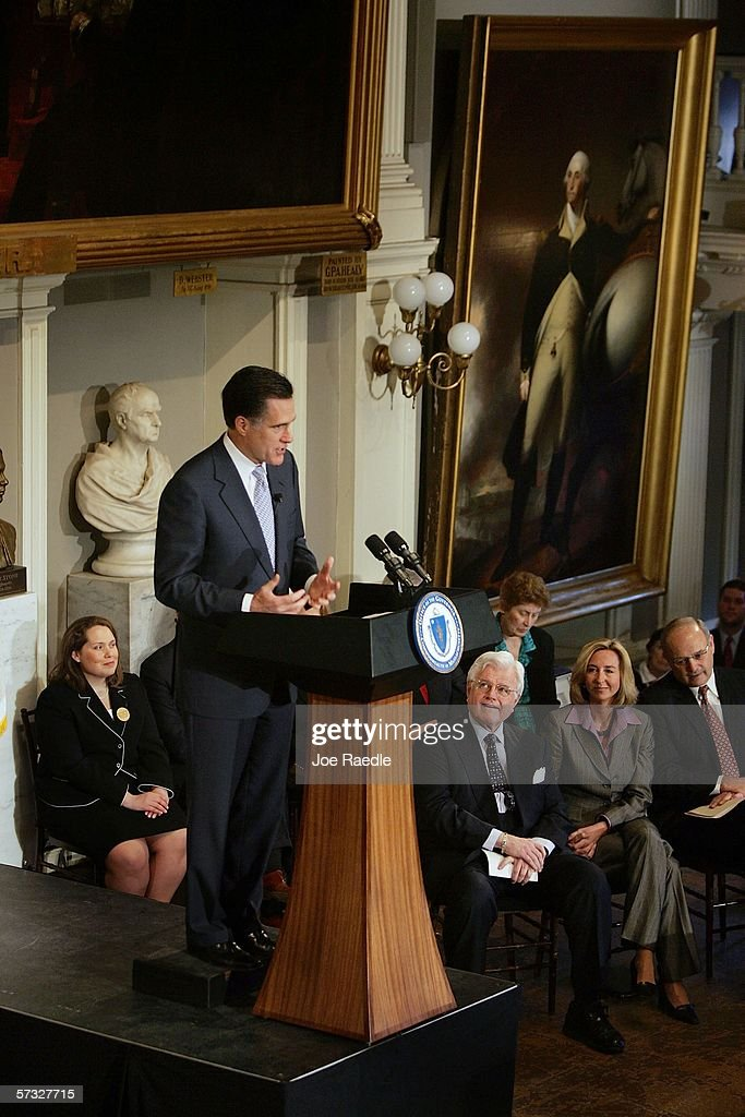 U.S. Sen. Edward Kennedy (D-MA) listens as Massachusetts Governor Mitt Romney speaks during a ceremony for Romney to sign a new health care reform bill at Faneuil Hall April 12, 2006 in Boston, Massachusetts. The law makes Massachusetts the first state in the country to require that all residents have health insurance.