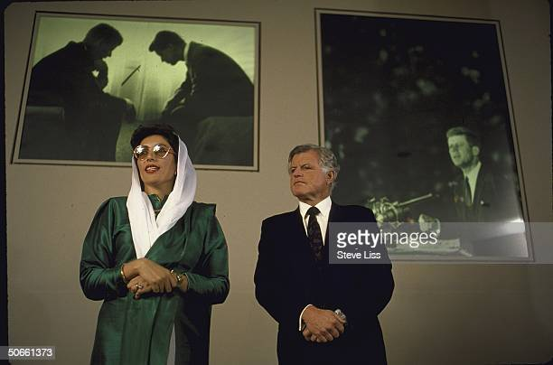 Sen Edward M Kennedy and Pakistani PM Benazir Bhutto in front of JFK Library photo exhibit showing John F Kennedy and Robert F Kennedy