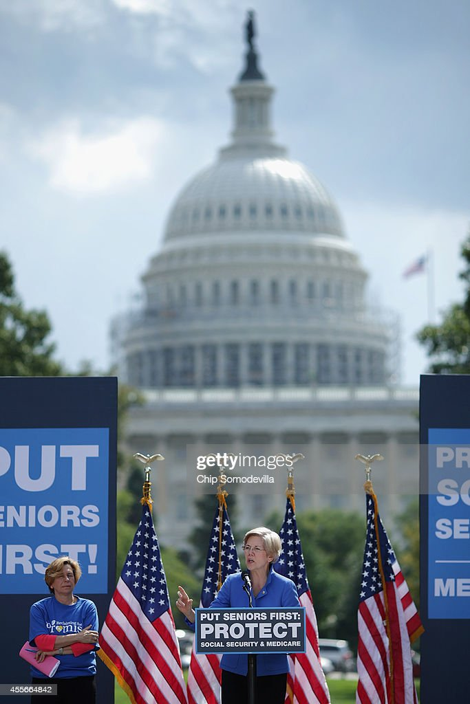 Sen. Elizabeth Warren (D-MA) (C) addresses a rally in support of Social Security and Medicare with American Federation of Teachers President Randi Weingarten (L) on Capitol Hill September 18, 2014 in Washington, DC. The rally was organized by American United for Change, a liberal advocacy group founded to fight the privitization of Social Security.