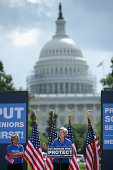 Sen Elizabeth Warren addresses a rally in support of Social Security and Medicare with American Federation of Teachers President Randi Weingarten on...