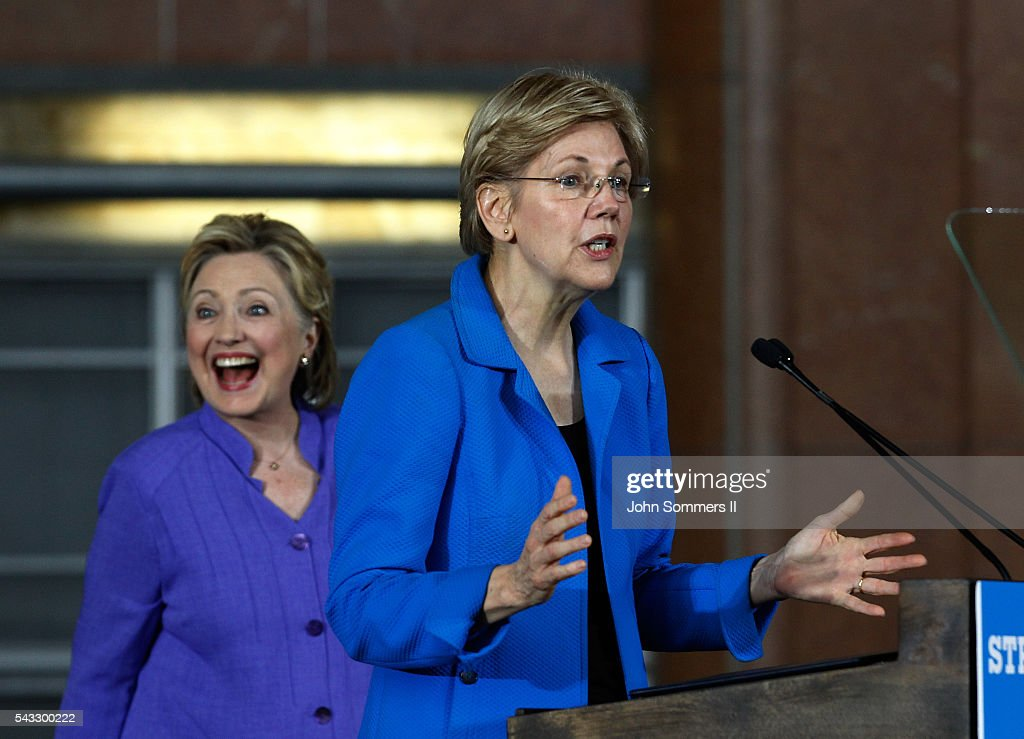 U.S. Sen <a gi-track='captionPersonalityLinkClicked' href=/galleries/search?phrase=Elizabeth+Warren&family=editorial&specificpeople=5396017 ng-click='$event.stopPropagation()'>Elizabeth Warren</a> (D-MA) (R) addresses the crowd as Democratic Presidential candidate <a gi-track='captionPersonalityLinkClicked' href=/galleries/search?phrase=Hillary+Clinton&family=editorial&specificpeople=76480 ng-click='$event.stopPropagation()'>Hillary Clinton</a> looks on during a campaign rally at the Cincinnati Museum Center at Union Terminal June 27, 2016 in Cincinnati, Ohio. Warren is helping Clinton campaign in Ohio.