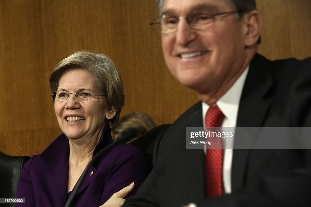 U.S. Sen. Elizabeth Warren (D-MA) (L) and Sen. <a gi-track='captionPersonalityLinkClicked' href=/galleries/search?phrase=Joe+Manchin&family=editorial&specificpeople=568465 ng-click='$event.stopPropagation()'>Joe Manchin</a> (D-WV) (R) during a confirmation hearing for Nominee for the Federal Reserve Board Chairman Janet Yellen before Senate Banking, Housing and Urban Affairs Committee November 14, 2013 on Capitol Hill in Washington, DC. Yellen will be the first woman to head the Federal Reserve if confirmed by the Senate and will succeed Ben Bernanke.