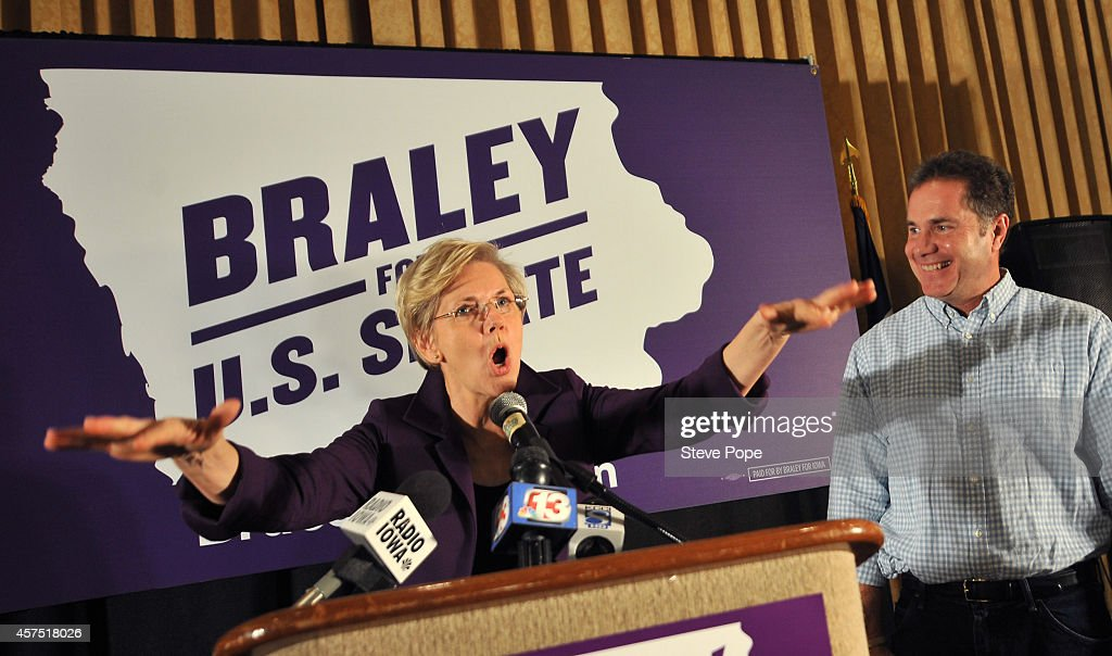 U.S. Sen. <a gi-track='captionPersonalityLinkClicked' href=/galleries/search?phrase=Elizabeth+Warren&family=editorial&specificpeople=5396017 ng-click='$event.stopPropagation()'>Elizabeth Warren</a> (D-MA) campaigns for U.S. Rep. <a gi-track='captionPersonalityLinkClicked' href=/galleries/search?phrase=Bruce+Braley&family=editorial&specificpeople=4841451 ng-click='$event.stopPropagation()'>Bruce Braley</a> (D-IA) on October 19, 2014 in Des Moines, Iowa. Braley is in a tight race for a Senate seat against Republican challenger Joni Ernst.
